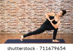 young asian woman practicing... | Shutterstock . vector #711679654