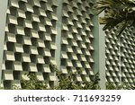Small photo of Color decoration of building exterior wall.Concrete ventilating block texture background.The smoothest and most modern blue building in front of architecture and buildings with shade and shade.