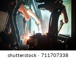 welding robots movement in a... | Shutterstock . vector #711707338