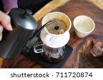 hand drip coffee  drip coffee... | Shutterstock . vector #711720874