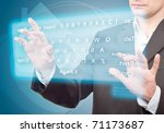 Hands pushing a button on a touch screen. Virtual Keyboard. - stock photo