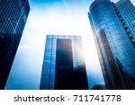 modern skyscrapers against sky...   Shutterstock . vector #711741778