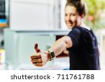 woman painting a cabinet with... | Shutterstock . vector #711761788