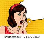 a girl  in shocked emotion.... | Shutterstock .eps vector #711779560