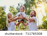 happy family playing with a... | Shutterstock . vector #711785308