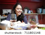 woman sits at dinning table | Shutterstock . vector #711801148