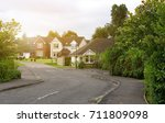 a quiet suburban road with well ... | Shutterstock . vector #711809098