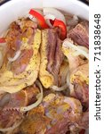 Small photo of Raw duck meat in marinade and with spices before cooking