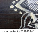 painted tribal pattern on wood... | Shutterstock . vector #711845143