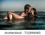 an attractive man and woman... | Shutterstock . vector #711846460