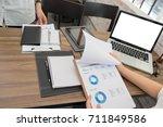 business people working... | Shutterstock . vector #711849586