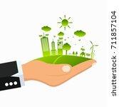 hand green ecology city... | Shutterstock .eps vector #711857104