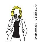 blonde hair businesswoman... | Shutterstock .eps vector #711861670