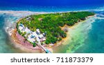 aerial photo of glover's reef... | Shutterstock . vector #711873379