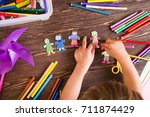 the child does figures of... | Shutterstock . vector #711874429