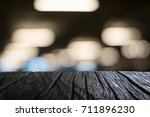image of wooden table in front... | Shutterstock . vector #711896230