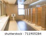 public toilet restroom lavatory ... | Shutterstock . vector #711905284