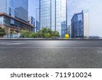 empty road with modern business ... | Shutterstock . vector #711910024