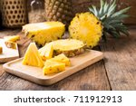 Pineapple On The Wooden Textur...
