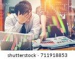 businessmen look at documents... | Shutterstock . vector #711918853