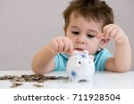 blurred baby boy putting some... | Shutterstock . vector #711928504