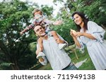 happy young family playing with ... | Shutterstock . vector #711949138