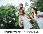 happy young family playing with ... | Shutterstock . vector #711949168