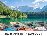 boats on the alpine lake near...   Shutterstock . vector #711950824