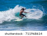 riding the waves. costa rica ... | Shutterstock . vector #711968614