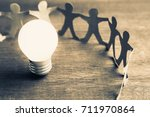 glowing light bulb with human... | Shutterstock . vector #711970864