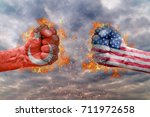 Two fist with the flag of Turkey and USA faced at each other ready for fight