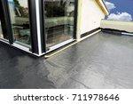 balcony waterproofing with foil | Shutterstock . vector #711978646