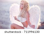 the beautiful girl with wings... | Shutterstock . vector #711996130