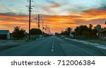 sunsetting in a small town.  | Shutterstock . vector #712006384
