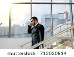 businessman talking on the... | Shutterstock . vector #712020814