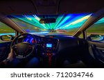 driving in thru night  blured... | Shutterstock . vector #712034746