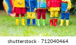 kids in rain boots. group of...   Shutterstock . vector #712040464
