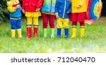 kids in rain boots. group of...   Shutterstock . vector #712040470