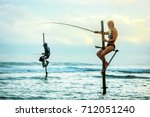 The European tourist catches fish in the traditional way. Indian Ocean. Sri Lanka.