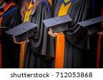 women's hands holding black... | Shutterstock . vector #712053868