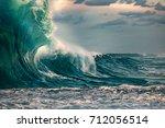 huge ocean wave during storm.... | Shutterstock . vector #712056514