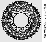 round lace flower element.... | Shutterstock .eps vector #712061608