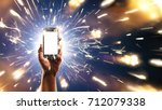 background. hand with phone on... | Shutterstock . vector #712079338