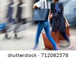 people shopping in the city in... | Shutterstock . vector #712082578