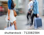 people shopping in the city in... | Shutterstock . vector #712082584