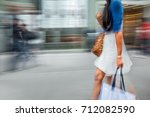 people shopping in the city in... | Shutterstock . vector #712082590