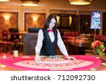 cute lady casino dealer at... | Shutterstock . vector #712092730