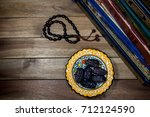 holy quran  dates and beads on... | Shutterstock . vector #712124590