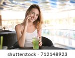 beautiful young woman with... | Shutterstock . vector #712148923