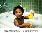 african descent kid enjoying...   Shutterstock . vector #712154494